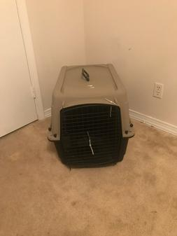 One time used dog crate tan and black colors made by great c